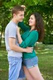 Romantic couple posing in city park, summer season, lovers boy and girl Stock Photo