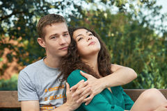 Romantic couple posing in city park, summer season, lovers boy and girl Royalty Free Stock Image