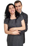 Romantic couple posing, dressed in black suit, isolated white Royalty Free Stock Photo