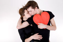 Romantic couple with red heart Stock Images