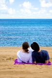 Romantic couple relaxing at the beach Stock Photo