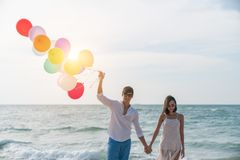 Romantic couple relaxing on the beach and enjoying beautiful sea stock image