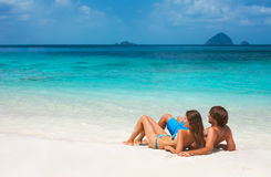 Romantic couple relaxing on the beach Stock Images