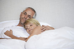 Romantic Couple Relaxing In Bed Stock Image