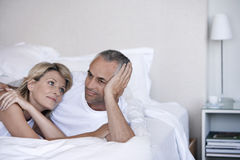 Romantic Couple Relaxing On Bed Royalty Free Stock Photo