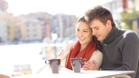 Romantic couple relaxing in a coffee shop royalty free stock photo