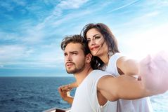 Romantic couple relaxing on the ferry. Romantic, young couple relaxing on the ferry Royalty Free Stock Image