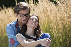 Romantic couple relaxing in field Royalty Free Stock Images