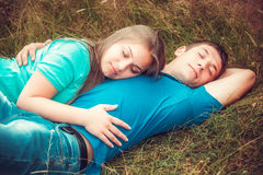 Romantic couple relaxing in field Royalty Free Stock Photography