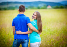 Romantic couple relaxing in field Stock Photo