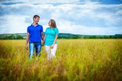Romantic couple relaxing in field Stock Photography