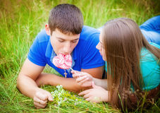 Romantic couple relaxing in field Stock Images