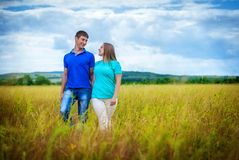 Romantic couple relaxing in field Stock Image