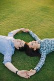 Romantic couple relaxing on grass Royalty Free Stock Photo
