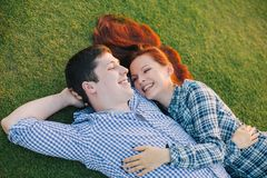 Romantic couple relaxing on grass Stock Image