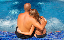Romantic couple relaxing near pool Stock Image