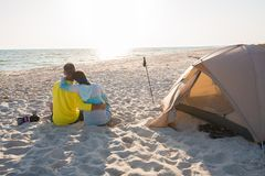Romantic couple is relaxing near a tent Royalty Free Stock Photography