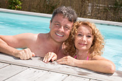 Romantic couple relaxing in the pool at summer Royalty Free Stock Photos