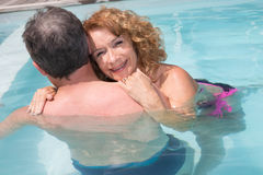 Romantic couple relaxing in the pool at summer Royalty Free Stock Image