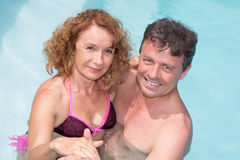 Romantic couple relaxing in the pool at summer Royalty Free Stock Photography