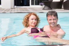 Romantic couple relaxing in the pool at summer Stock Photo
