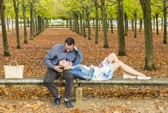 Romantic Couple in a Park in Autumn Stock Photography