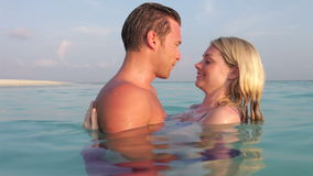 Romantic Couple Relaxing In Tropical Sea stock video footage