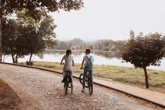 Romantic couple riding bicycles stock photo