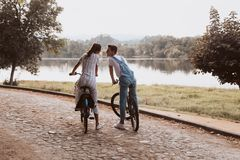 Romantic couple riding bicycles stock photography