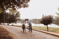 Romantic couple riding bicycles royalty free stock photography