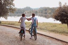 Romantic couple riding bicycles stock image