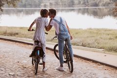 Romantic couple riding bicycles royalty free stock photo