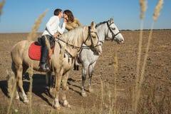 Romantic couple riding Stock Image