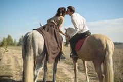 Romantic couple riding Stock Photography