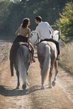 Romantic couple riding Stock Photos