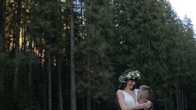 Romantic couple on the road. Groom spining bride on his hands. Slow motion stock video footage