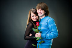 Romantic couple with rose. Studio shot Stock Images