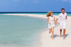 Romantic Couple Running On Beautiful Tropical Beach. Holding Hands Royalty Free Stock Image