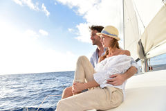Romantic couple on a sailing boat admiring seaview Stock Photos