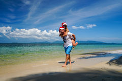 Romantic Couple with Santa Claus Hats Have Fun on the Beach. Celebrating Christmas and New Year in Hot Country Stock Image