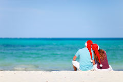 Romantic couple in Santa hats Royalty Free Stock Photography