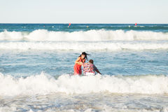 Romantic couple in the sea Stock Images