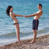 Romantic couple on seashore Stock Photography
