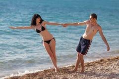 Romantic couple on seashore Royalty Free Stock Photos