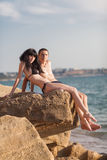 Romantic couple on seashore Stock Photos