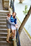 Romantic couple at the Seine embankment Stock Photos