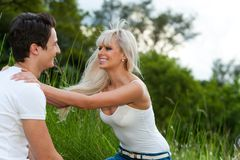 Romantic couple showing affection outdoors. Stock Image