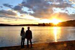 Romantic Couple in Silhouette. Standing on the beach of the Lake of Two Rivers, Algonquin, Canada Royalty Free Stock Photo