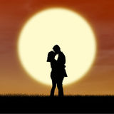 Romantic couple silhouette kiss by sunset Royalty Free Stock Images