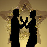 Romantic couple silhouette sharing glass of champagne Stock Photos